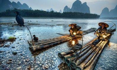 Pescatori con i loro cormorani